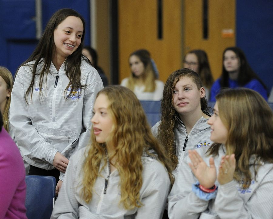 Warren Township High School freshman swimmer Keegan Knott was honored Monday by her teammates and other students during a celebration rally Monday. Keegan won four medals at the state swimming meet in November.