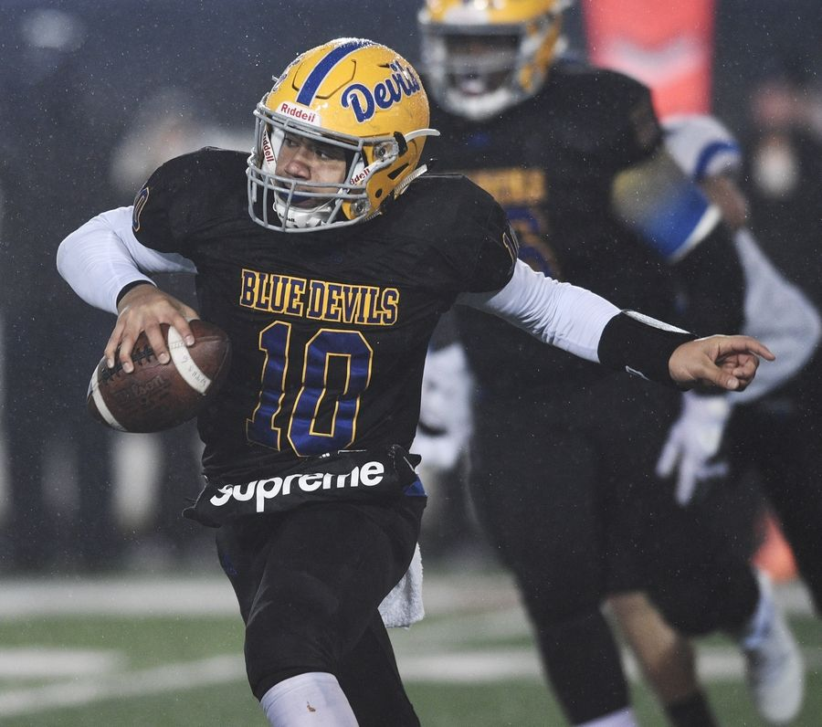 Warren quarterback Trinate Jacobs scrambles for yardage during the Class 8A state championship against Lincoln-Way East at in DeKalb on Saturday night.