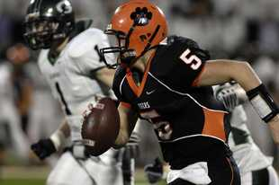 Wheaton Warrenville South quarterback Reilly O'Toole runs for yardage in the second half of the Tigers' Class 7A title game victory over Glenbard West in 2009.