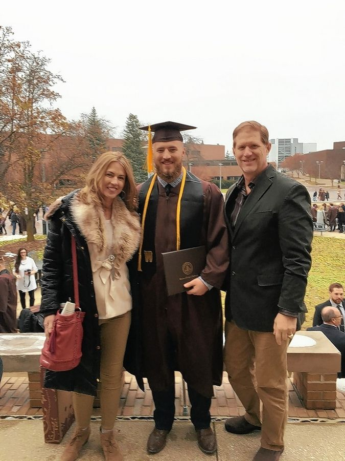 Luke Juriga at his graduation from Western Michigan University with his parents Denise and Jim.