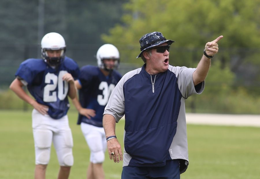 Bev Horne/bhorne@dailyherald.comLisle head coach Paul Parpet Sr. leads football practice on Monday.