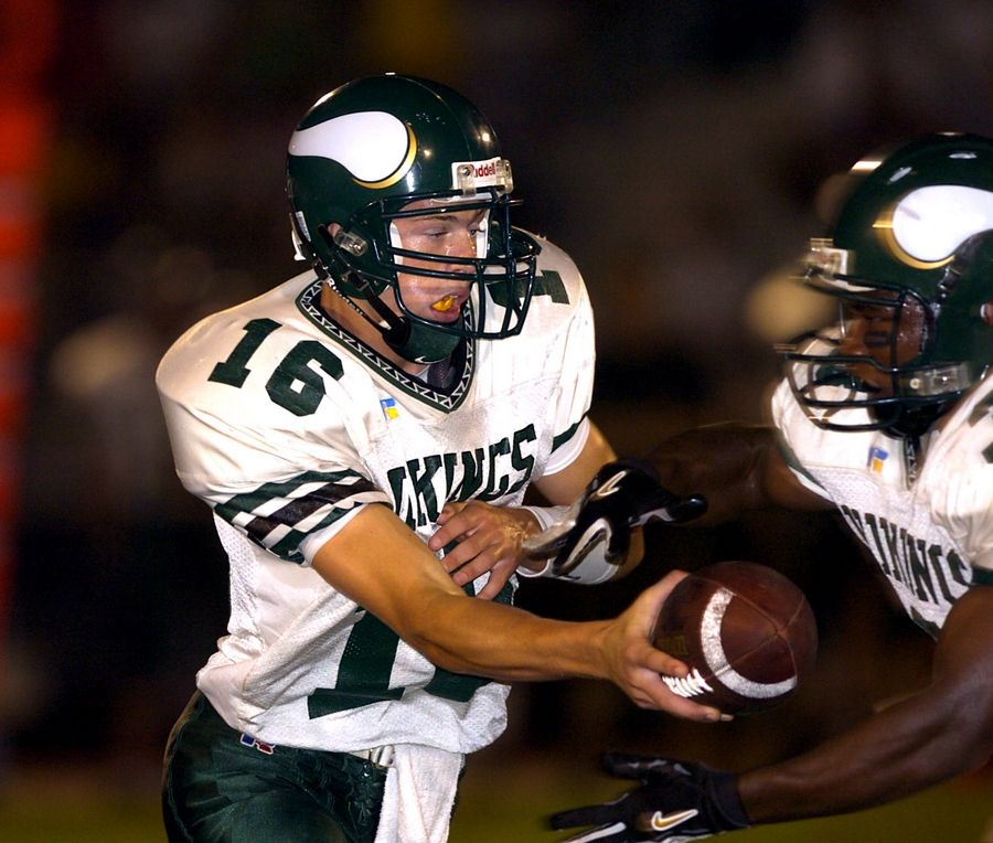 Fremd quarterback Scott Tolzien (16) hands off during a game in 2004.