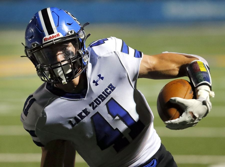 Lake Zurich's Jack Dwyer heads into the end zone for a touchdown during action at Lake Forest last season.