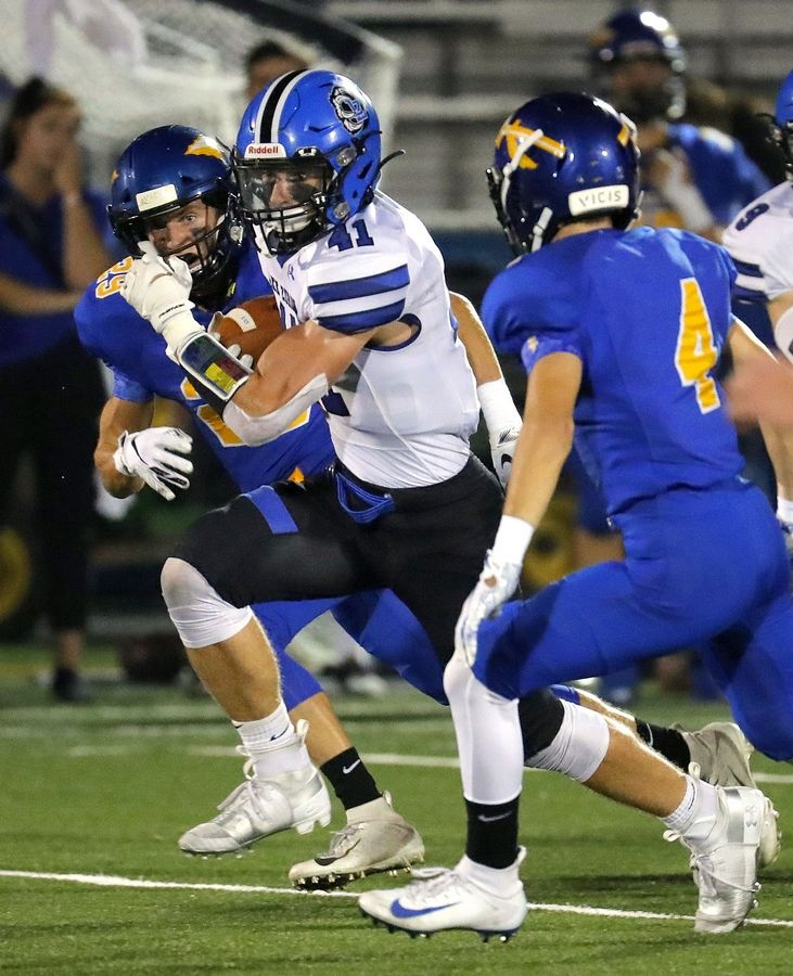 DAILY HERALD FILE PHOTOLake Zurich running back Jack Dwyer takes off during action at Lake Forest last season.
