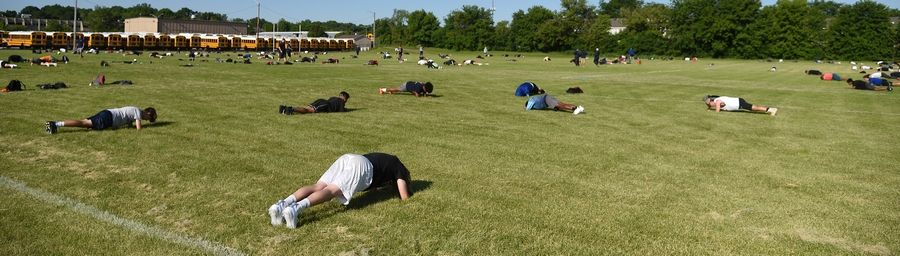 Naperville North was among the first area high schools to begin team conditioning on Monday. Football players were in the first wave of athletes who spaced out for drills.