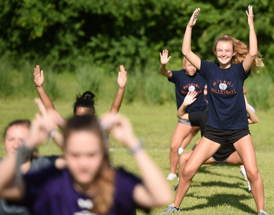 Naperville North senior Tillie Inglis and her lacrosse teammates participate in the school's first day of athletic conditioning on Monday.