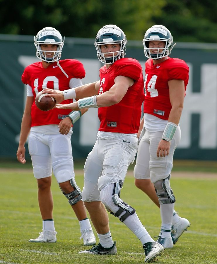 Naperville Central graduate Payton Thorne, left, is vying for the starting quarterback position at Michigan State.