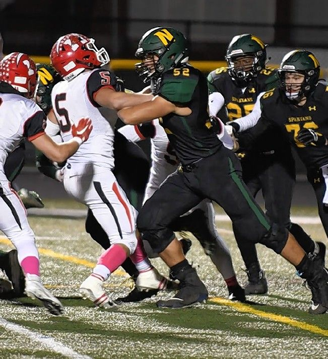 Under the Illinois State Board of Education guidelines District 225 observes, Glenbrook North offensive tackle Jackson Carsello (52) will have to wait a little while longer to block someone.