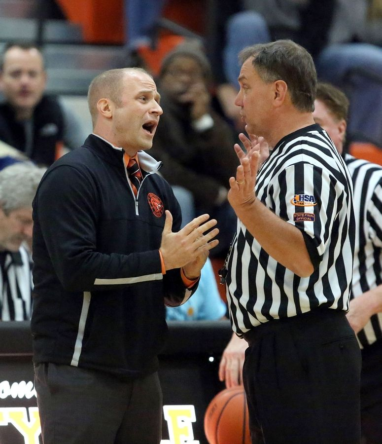 Libertyville basketball coach Brian Zyrkowski argues with the referee after a call.