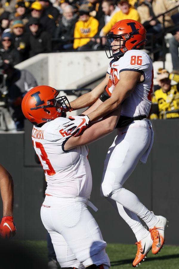 Illinois offensive lineman and Prospect graduate Alex Palczewski celebrates with wide receiver Donny Navarro after a touchdown against Iowa last season.