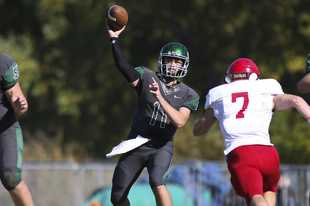 Glenbard West's Braden Spiech passes the ball against Hinsdale Central last season.