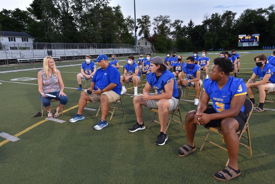 Warren High School football coach Bryan McNulty and some of his senior players sit on the school's football field and talk with Daily Herald sports writer Patricia Babcock McGraw about the delayed season due to COVID-19 restrictions.