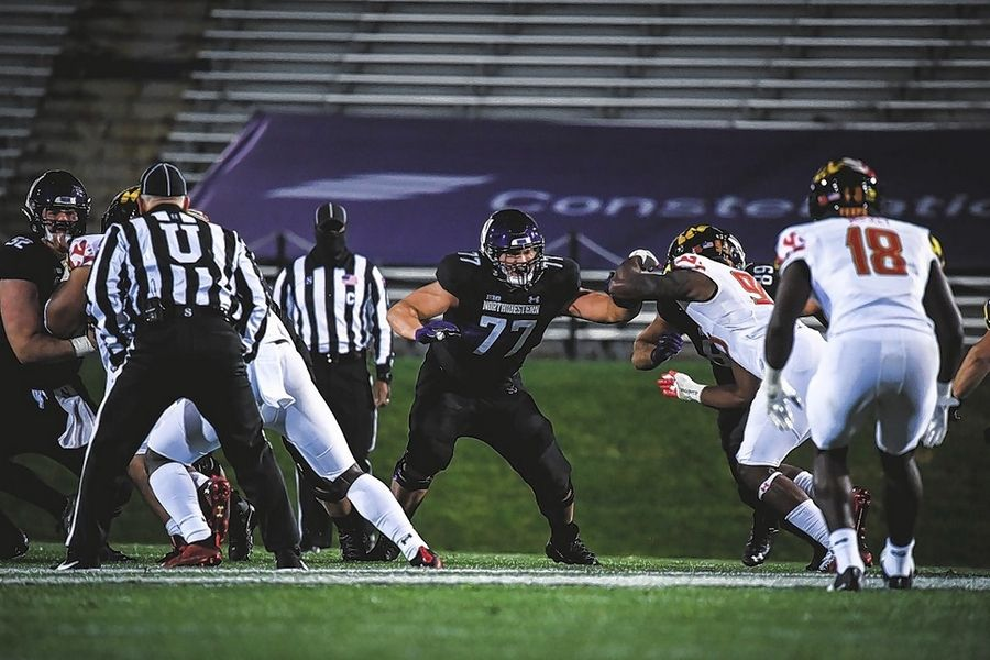 Maine South graduate Peter Skoronski is starting on the offensive line at Northwestern as a true freshman.