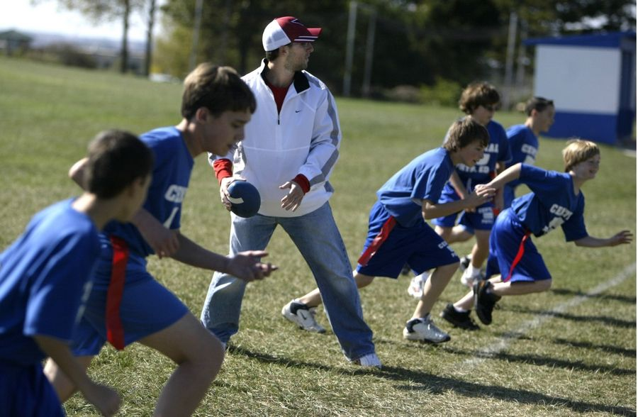 Former Burlington Central and NIU football star Dan Sheldon plays flag football with seventh-graders at Burlington Middle School in 2005.