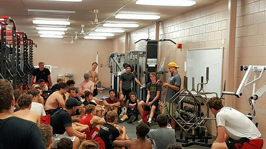 Barrington High School graduate Scotty Miller (yellow hat) speaks to the Barrington football team during the summer of 2019. Miller is a wide receiver for the Tampa Bay Buccaneers.