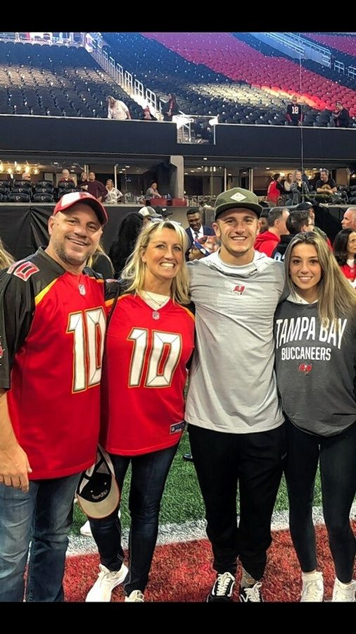 Scott and Kristy Miller with their son, Scotty, and his wife, Jenna. The Barrington High School grad is a wide receiver for the Super Bowl-bound Tampa Bay Buccaneers.