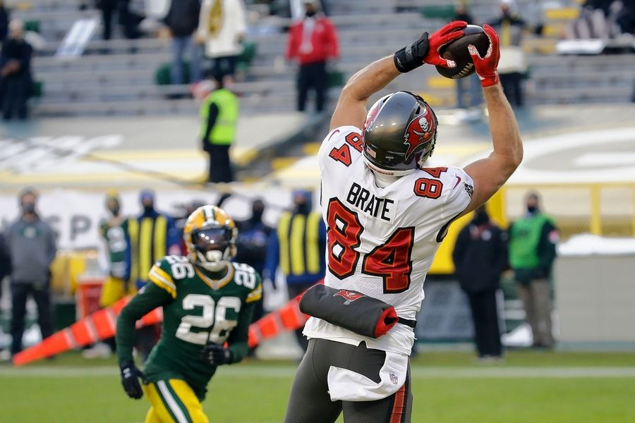Tampa Bay Buccaneers tight end Cameron Brate catches an 8-yard touchdown pass against the Packers during the NFC Championship Game Sunday, Jan. 24, 2021, in Green Bay, Wis. Brate played football, basketball and baseball at Naperville Central, graduating in 2009.