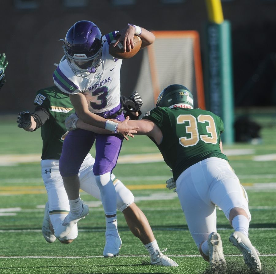 Stevenson's Daniel Orgler snags Waukegan's quarterback Tavion Strawder for a loss in the first game of the season at Stevenson High School on Friday.
