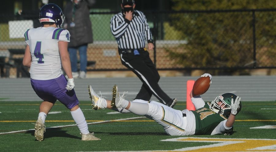 Stevenson's Andrew Miller scores in the first quarter despite pressure from Waukegan's Michael Angulo in the first game of the season at Stevenson High School on Friday.