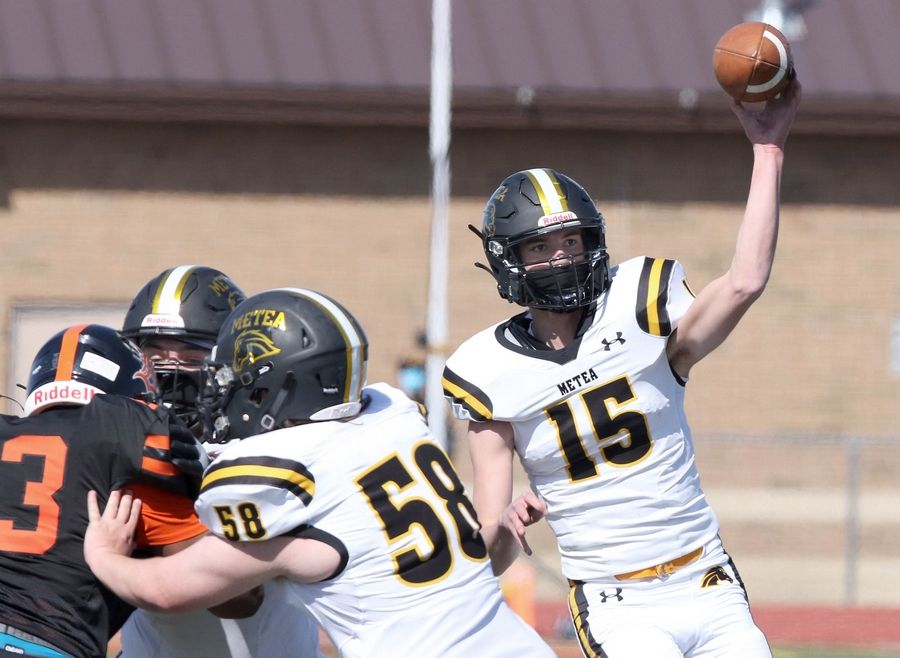 Metea Valley quarterback Logan Frederick fires a pass during their game against DeKalb Saturday afternoon at DeKalb High School.