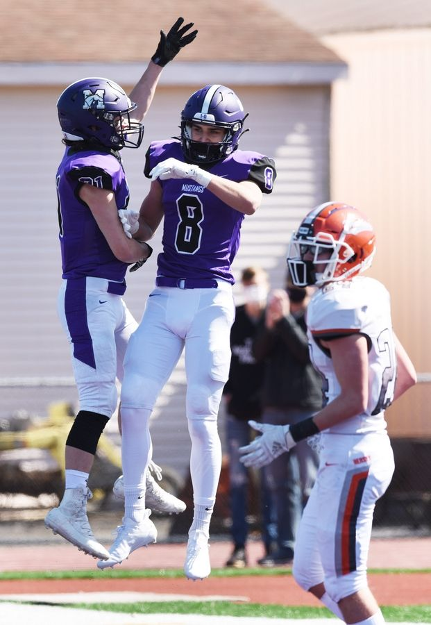 Rolling Meadows' Daniel Sobkowicz (8) celebrates scoring a touchdown with teammate Ethan Groark during last Saturday's game against Hersey.