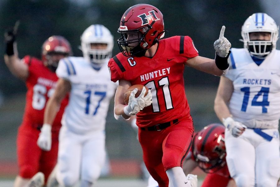 Huntley's Alex Janke holds his finger up in the air as he runs the ball into the end zone for the first touchdown against Burlington Central Friday in Huntley.