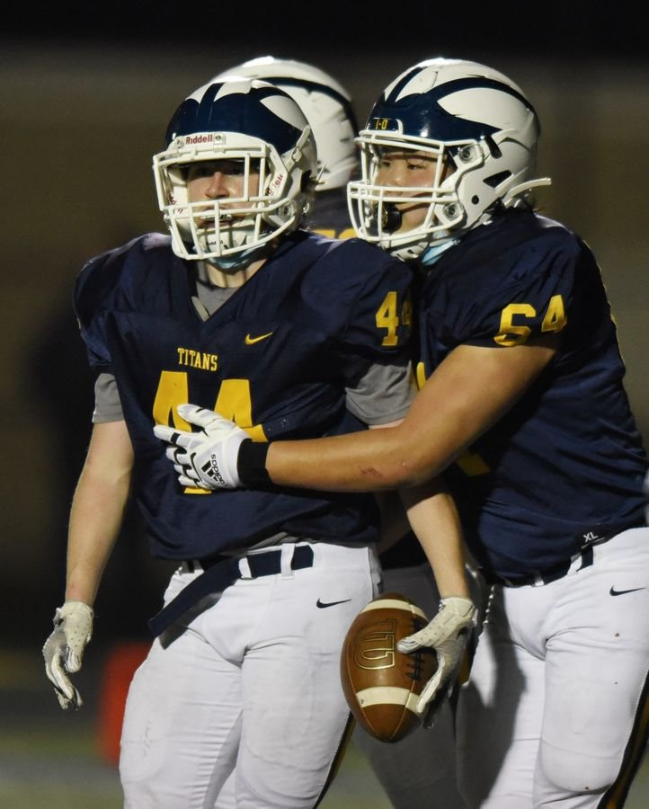 Glenbrook South's Mathew Burda, left, with teammate Daniel Choi, has the ball after a two-point conversion.