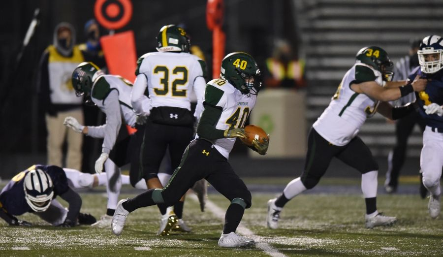 Glenbrook North's Quinn Clarke returns the kickoff to start the second half of Friday's game at Glenbrook North.