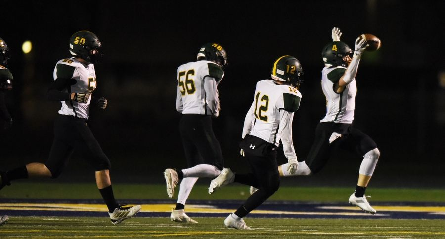 Glenbrook North's Ryan Henchel, right, celebrates his touchdown with, from left, teammates Sam Dawson, Aidan Casey and Murphy Mulvihill at the end of the first half of Friday's game at Glenbrook South.