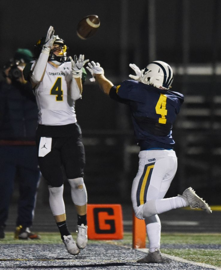 Glenbrook North's Ryan Henchel catches a touchdown pass ahead of Glenbrook South's Anthony Travlos.