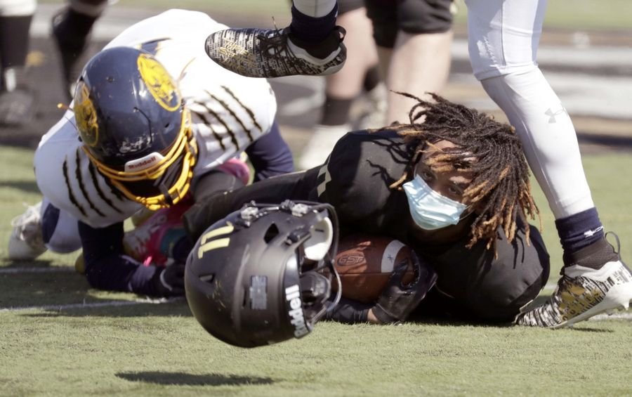 Grayslake North's Tony Hines loses his helmet as he is being tackled against Round Lake last week.