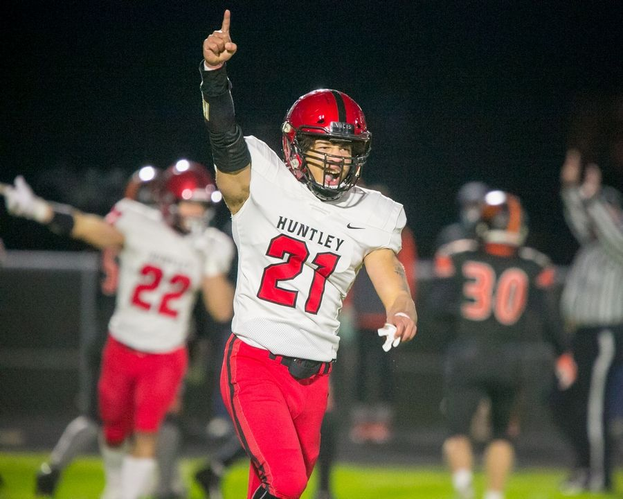 Huntley's Edward Wall (21) celebrates after a blocked punt attempt in the second quarter of the game at McHenry High School East Campus on Thursday, April 1, 2021, in McHenry, Ill.