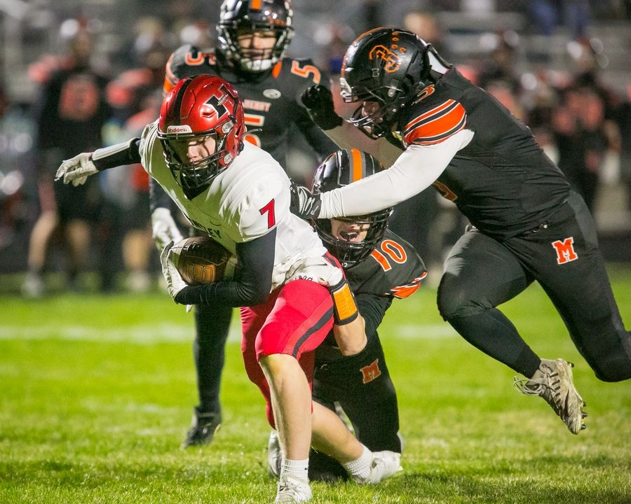 Huntley's Jason Coleman (7) runs the ball past Warrior defenders in the second quarter of the game at McHenry High School East Campus on Thursday, April 1, 2021, in McHenry, Ill.