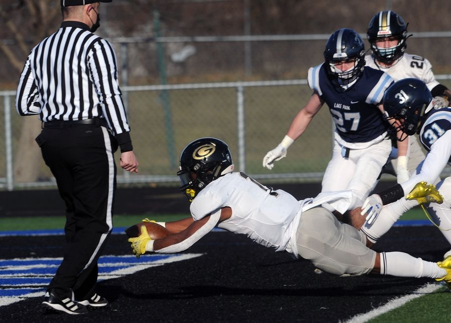 Glenbard North's Denhim Betney dives into the end zone for a touchdown Friday in the first quarter of the Panthers' 28-0 win at Lake Park.