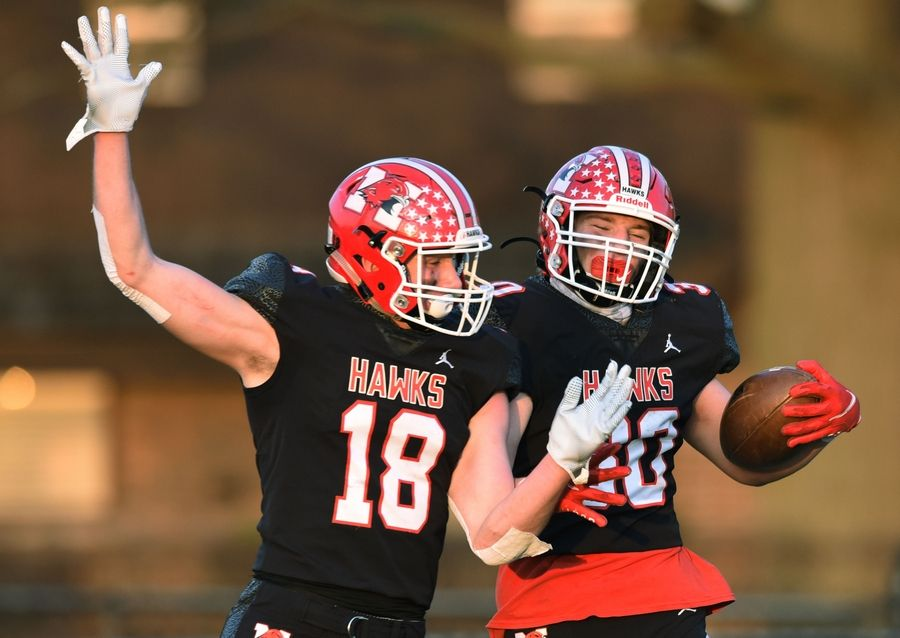 Maine South's Mike Sajenko, right, celebrates his second-quarter touchdown with teammate Chris Petrucci during Saturday's game against Glenbrook North.