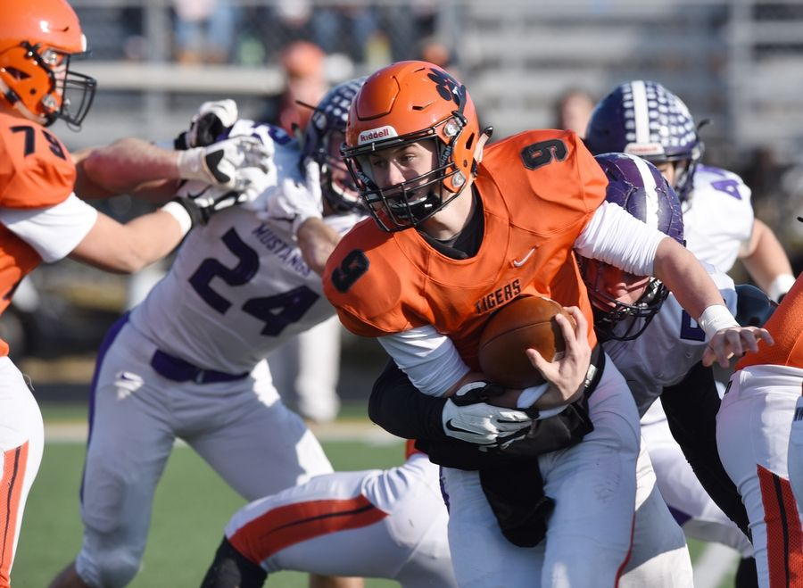 Wheaton Warrenville South quarterback Parker Brown carries the ball against Rolling Meadows in  2019 playoff game.