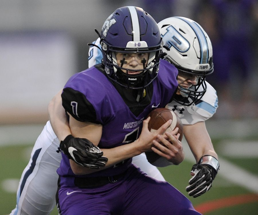 Rolling Meadows quarterback Michael Radon is sacked by Prospect's Kris Bohnen in the first quarter of a football game in Rolling Meadows Friday.