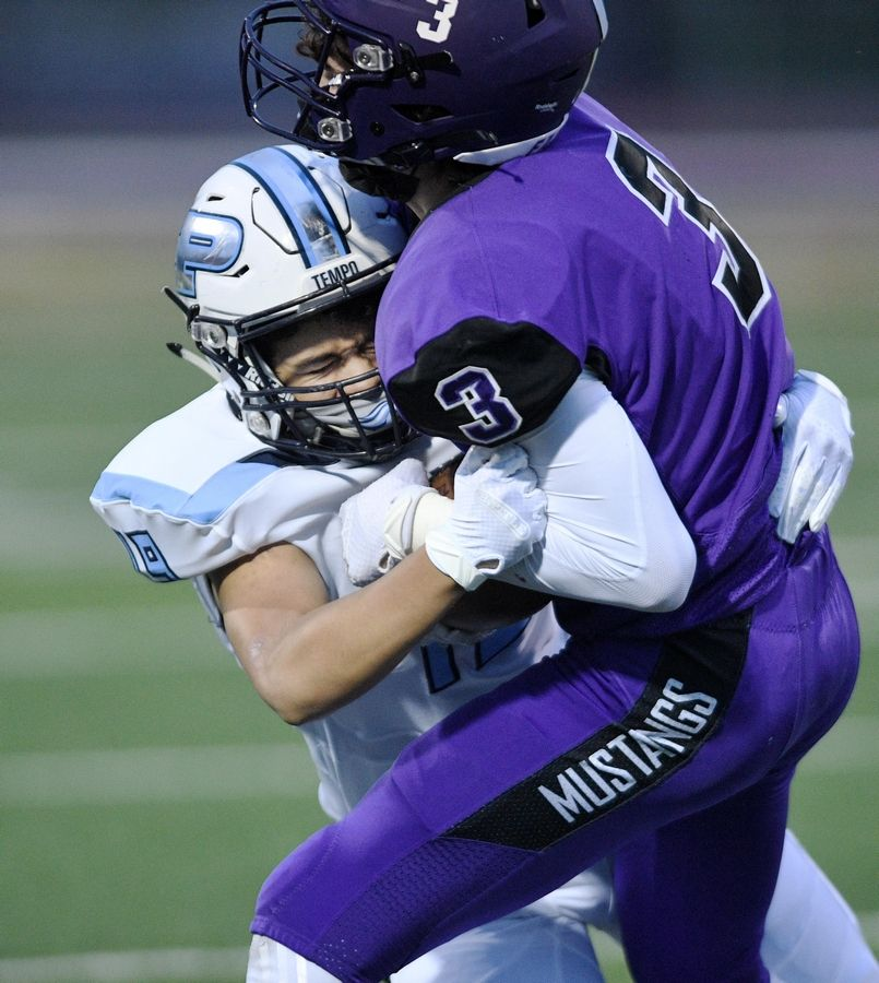 Prospect's Chris Rodriquez stops Rolling Meadows' Michael Sobkowicz in a football game in Rolling Meadows Friday.