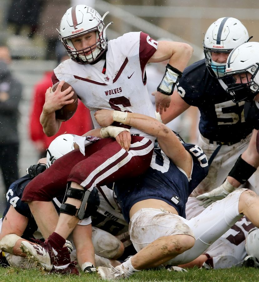 Prairie Ridge quarterback Taidhgin Trost is taken down in the backfield by Cary-Grove's Michael Dec during their football game on Saturday, April 10, 2021 at Cary-Grove High School in Cary. Cary-Grove won 20-7.