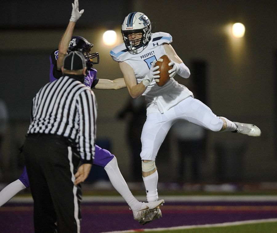 Prospect's Frank Covey catches a long pass as Rolling Meadows' Sean Grant defends last week. Prospect travels to Buffalo Grove Friday night with the Mid-Suburban East title on the line.