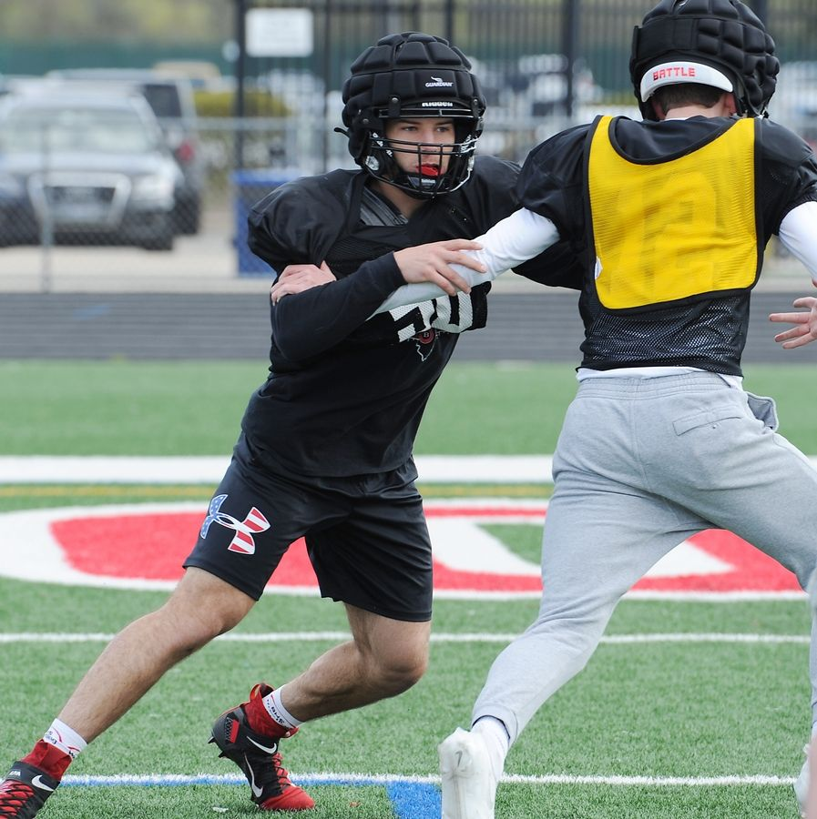 Barrington football standout Evan Roper, who has returned from a broken leg to become the team's best defensive player, practices with his teammates before taking on Hoffman Estates.
