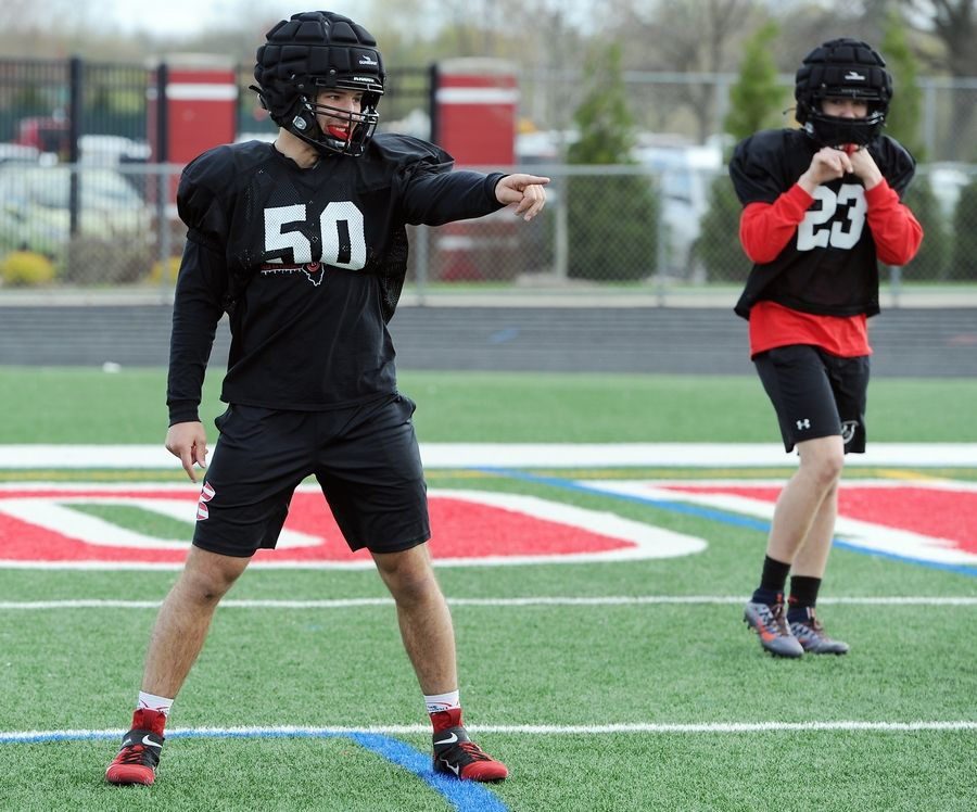 Barrington football standout Evan Roper, who has returned from a broken leg to become the team's best defensive player, practices with his teammates at the Barrington High School football field.