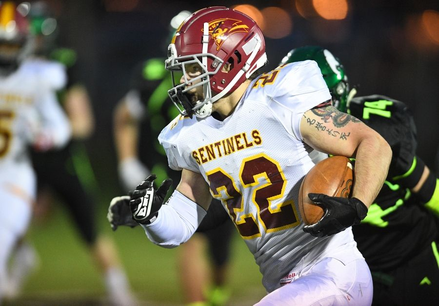 Westmont's Benjamin Juska runs against St. Edward in a Monday night football game in Elgin on Monday, April 19, 2021.