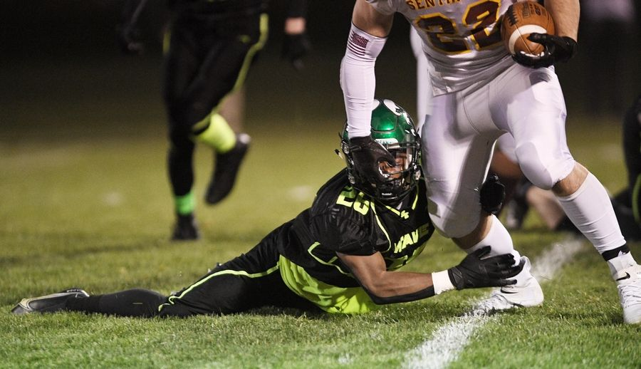 St. Edward's Clemon Mccullough II stops Westmont's Anthony Kirkwood in a Monday night football game in Elgin on Monday, April 19, 2021.