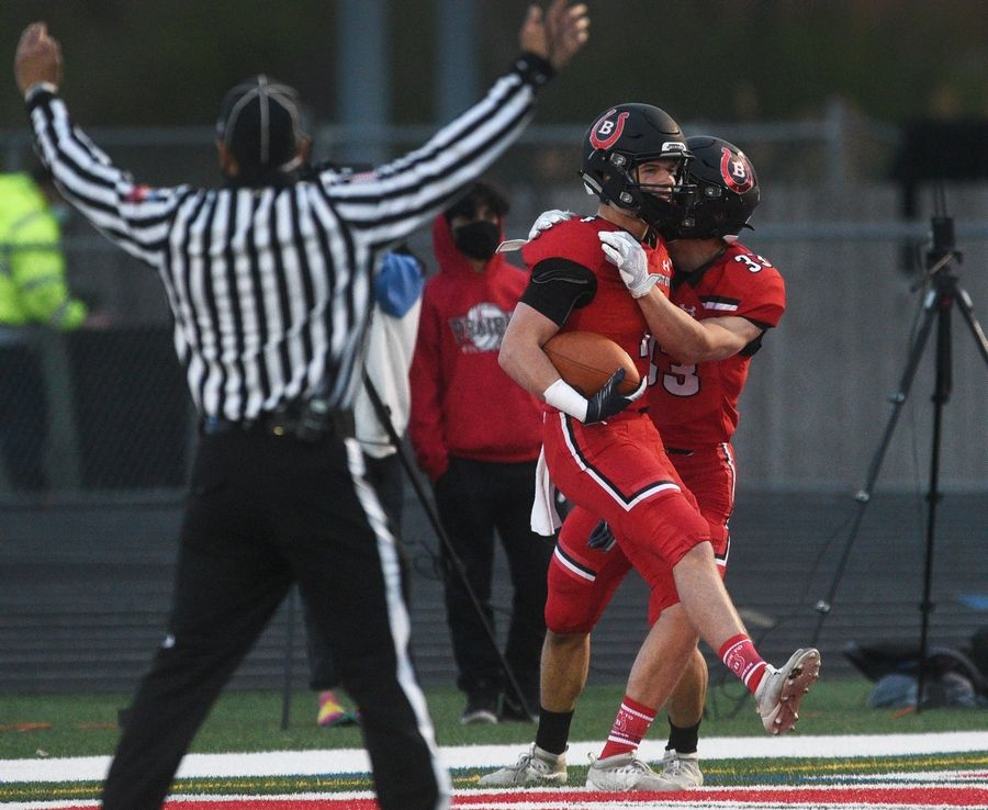 The referee signals the Barrington touchdown by Joey Gurskis, who celebrates with teammate Tom Sweeney (33) during Friday's football game against Prospect in Barrington.