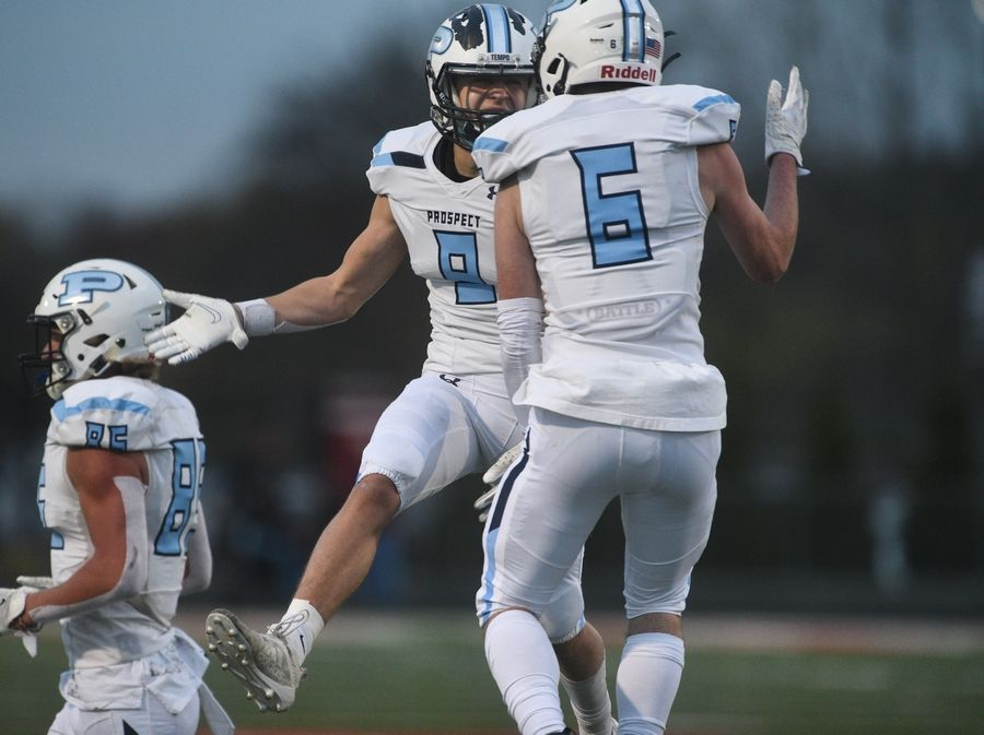 Prospect's Frank Covery (6) celebrates his touchdown with teammate Wes Neumann (9) during Friday's football game in Barrington.