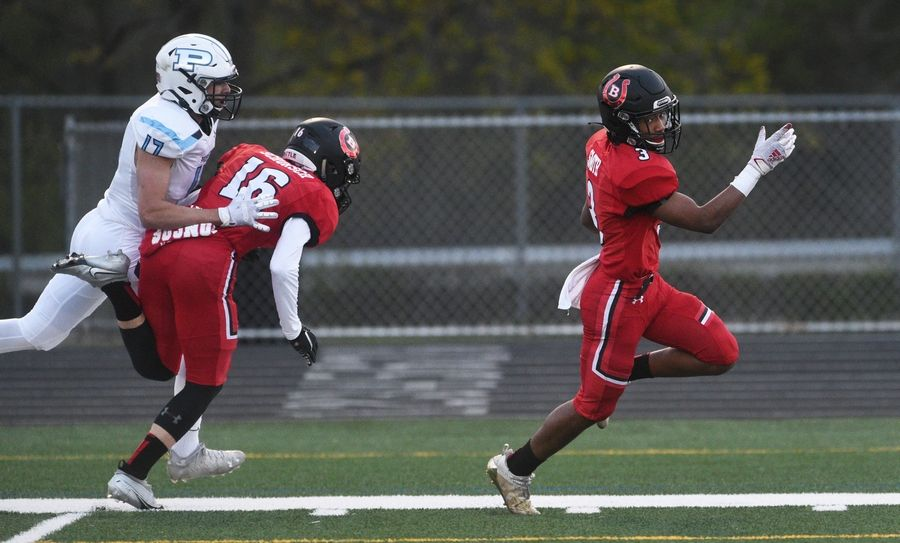 Barrington's Ryan Smith (3) runs in for a touchdown as teammate Dres Schorsch (16) provides a block on Prospect's Gino Paredes during Friday's football game in Barrington.