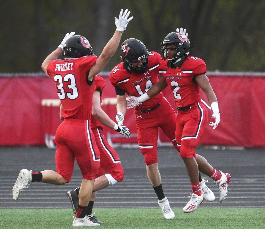 Barrington's Bryan Smith, right, celebrates one of his touchdown runs with teammates during Friday's football game against Prospect in Barrington.