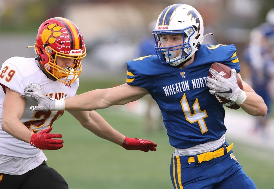 Wheaton North junior Seth Kortenhoeven tries to fend off the tackle of Batavia senior 	Anthony Bradley after a long catch and run down to the 1-yard line during their game Saturday afternoon in Huskie Stadium at Northern Illinois University.