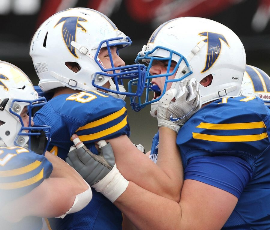 Wheaton North tight end Casey Morrison (left) is congratulated by his teammates after a touchdown catch during their win over Batavia Saturday afternoon at Huskie Stadium in DeKalb.